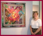 "Photo of Dottie Gantt with ""If It Is Not One Thing, It's ..."" in the show ""Eclectic Expressions: Works by Southeastern Textile Artists"", Atlanta, GA in 2001"